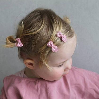 Kindermusthaves - Roze strikjes met stipjes!