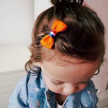 Kindermusthaves - Oranje haarspeldje!