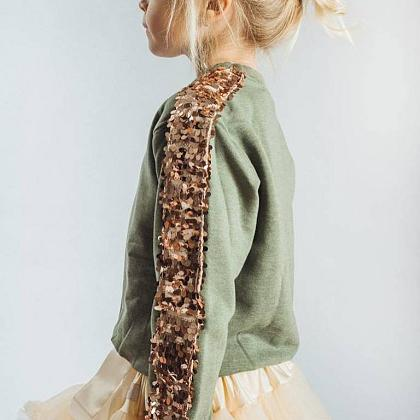 Kindermusthaves - Deze sweater is goud waard!