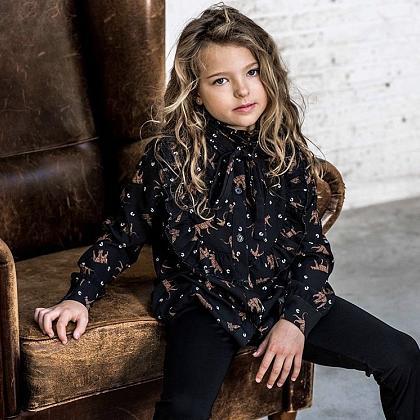 Kindermusthaves - Ruffle blouse met leopard!